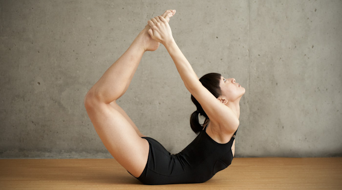 Beautiful Woman Doing Floor Bow Pose