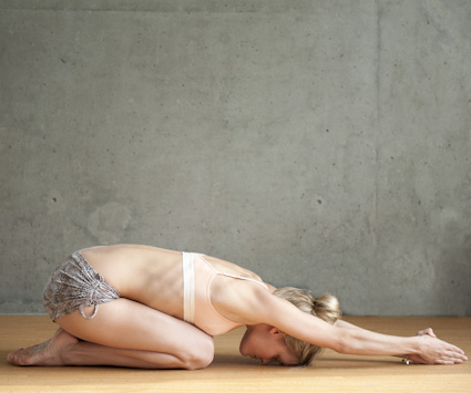 Beautiful Woman doing Half Tortoise Pose