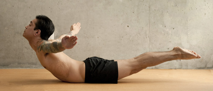 Man Doing Full Locust Pose