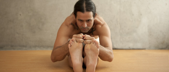 Man Doing Head to Knee Pose Bikram Yoga Pose