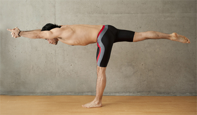 Man doing balancing stick pose
