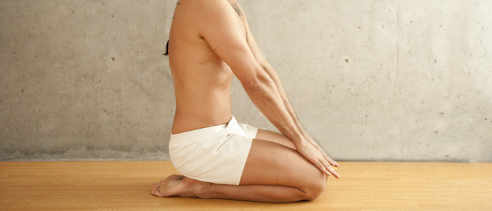 Man doing final breathing exercise in Bikram Yoga