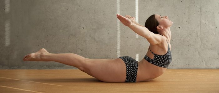 Woman Doing Full Locust Pose