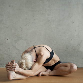Woman Doing Head to Knee Pose - Bikram Yoga Pose
