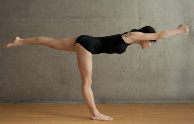 Woman doing Balancing Stick Pose