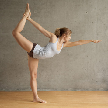 Woman doing Standing Bow Pose